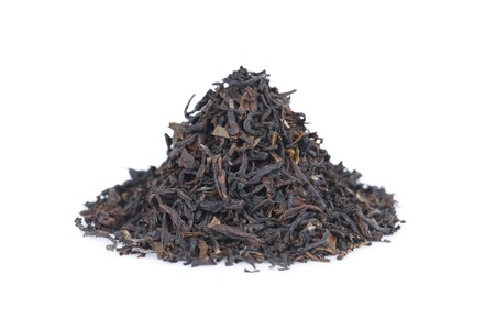 It is Pile of black tea isolated on white.