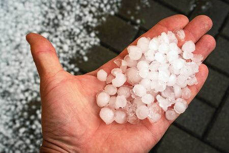 Photo for seasonal background ice hail on hand - Royalty Free Image