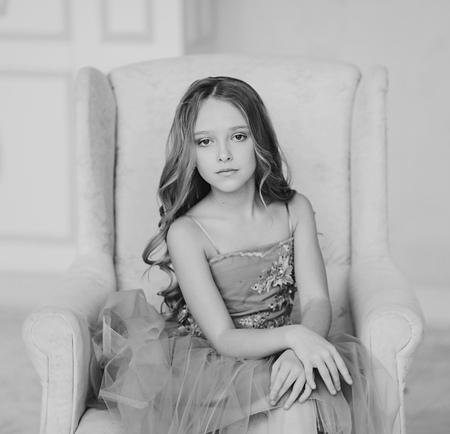 Foto de Monochrome portrait of a charming brunette little girl - Imagen libre de derechos