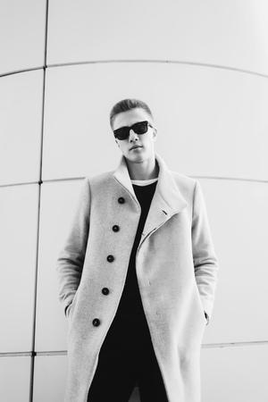 Foto de Black and white portrait handsome man in a coat - Imagen libre de derechos
