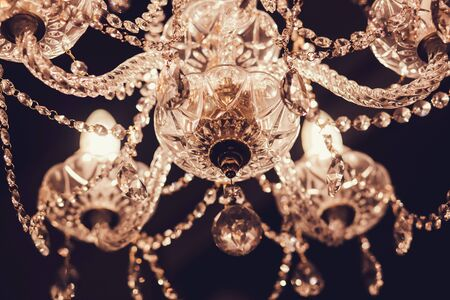 Photo pour crystal chandelier hanging from the ceiling in the room - image libre de droit