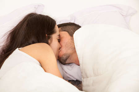 Photo for Portrait of a young couple in love in a bed - Royalty Free Image