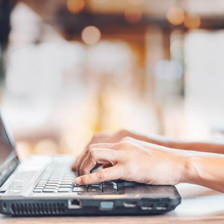 Foto de Close up man's hand using laptop in home. - Imagen libre de derechos