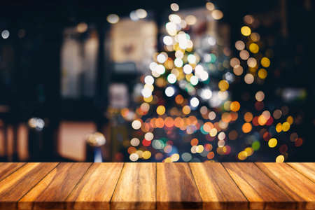 Photo pour Wood table top on blur Christmas tree background. For display or montage your products. - image libre de droit