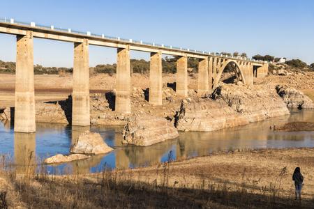 The Ricobayo reservoir (Embalse de Ricobayo) and the Puente de la Estrella arch bridge over the Esla river in Zamora, Castile and Leon, Spain. Almost dried during winter 2018