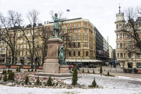 Helsinki, Finland. Monument to Finland-Swedish lyric and epic poet Johan Ludvig Runeberg in a cold winter day, covered in ice and snow