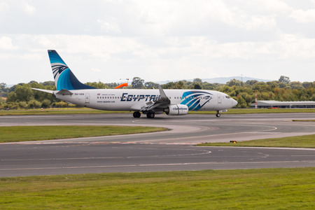 EgyptAir Boeing 737 narrow-body passenger plane SU-GEB taxiing, Manchester International Airport.