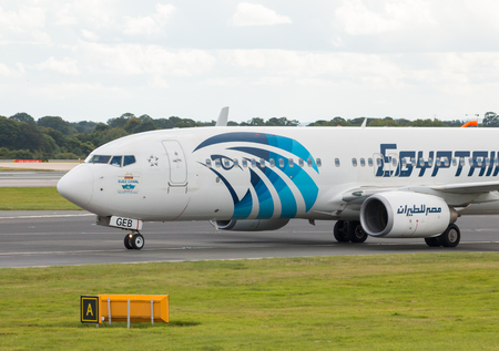 EgyptAir Boeing 737 narrow-body passenger plane SU-GEB taxiing on Manchester International Airport taxiway.
