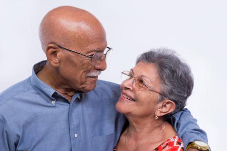Photo pour An smiling elderly couple, both wearing glasses. - image libre de droit