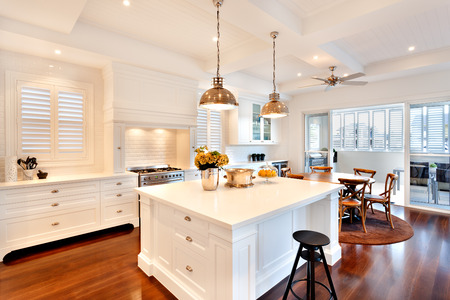 Photo pour Attractive and beautiful kitchen having glossy wooden floor of a luxury house - image libre de droit