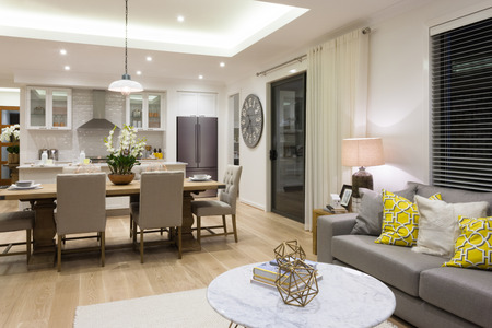 Photo pour Luxury living room beside a dining room attached to  the kitchen included pillows on sofas next chairs and table setup - image libre de droit