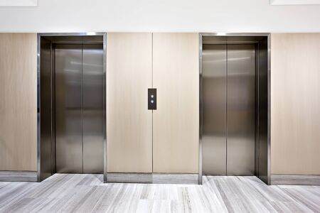 Photo pour Modern silver elevator in a luxury building  with door closed - image libre de droit