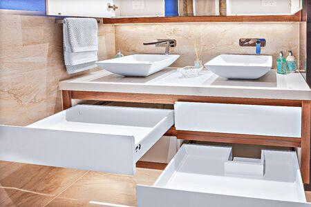 Foto de Neatly-designed vanity basins with spacious cabinets and designer taps - Imagen libre de derechos