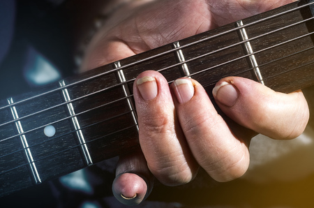 old, woman, man playing electric, acoustic guitar, black background, lifestyle