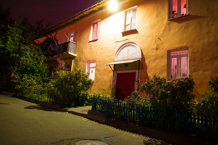 The Entrance Of A Small Cozy House At Night In Europe Old House