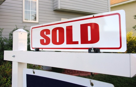 A real estate sign symbolizing a home sold