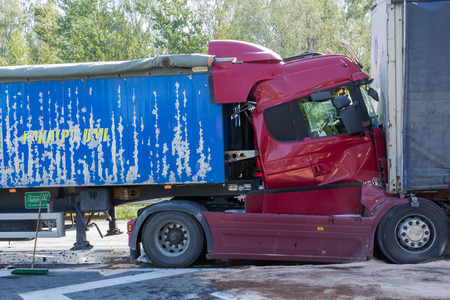 The collision of two trucks in Latvia, on the A8 road, occurred on August 23, 2018.The truck driver Iveco saw people on the pedestrian crossing and braked sharply, behind the driver who was driving Scania did not observe the distance and ran into Iveco. b