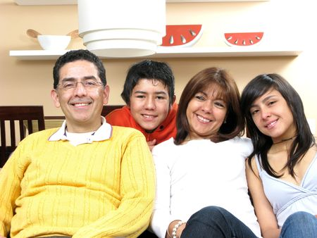Beauty family sitting in living room smiling
