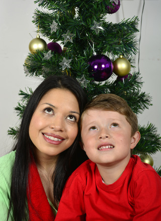 Photo pour Happy family laying under the christmas tree with a white. - image libre de droit