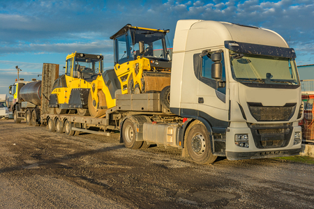 Photo for Road transport of heavy machinery in large trucks - Royalty Free Image