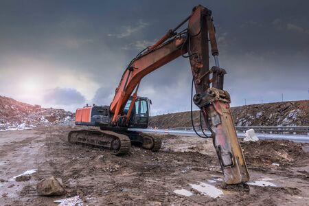 Photo for Earth moving by a bulldozer in the construction of a road in Spain. Hydraulic hammer for backhoe - Royalty Free Image