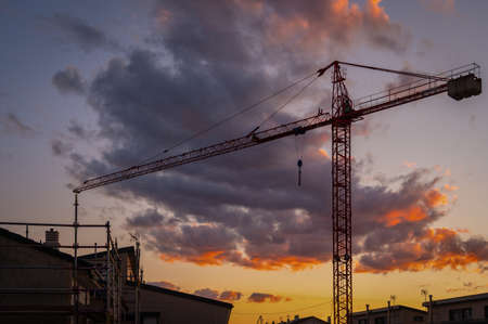 Photo for Silhouette of a crane at a construction site at sunset - Royalty Free Image