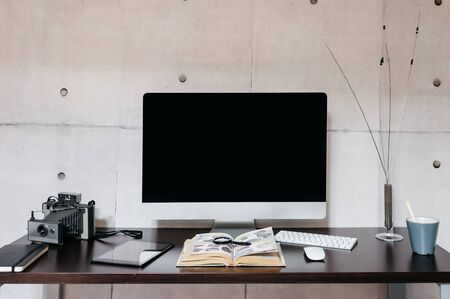 Photo for A desk with a computer on a table - Royalty Free Image