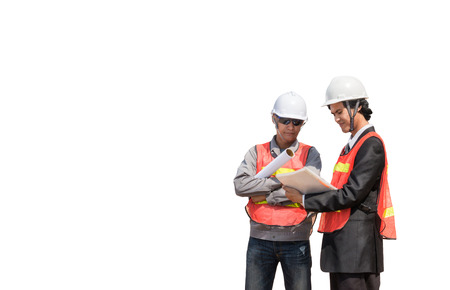 Photo pour two engineers with blueprints isolated on white background - image libre de droit