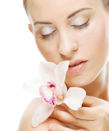 Photo pour Beautiful woman with orchid flower - image libre de droit