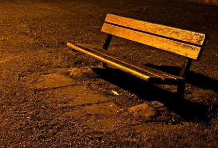 old and lonely park bench at night
