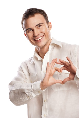 Portrait of happy man making heart from his hands on white background