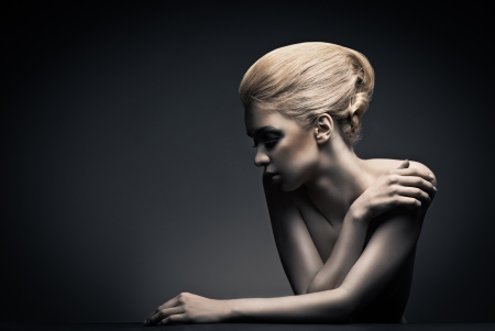 Photo for Beautiful high fashion female model with abstract hair style behind the table - Royalty Free Image