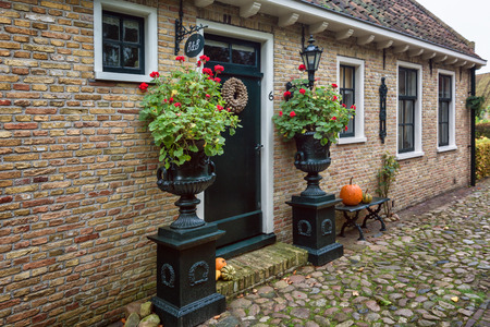 Photo pour Bourtange, The Netherlands, November 7, 2017: The decorated front of a Bed and Breakfast in Bourtange, a Dutch fortified village in the province of Groningen in the north of the Netherlands - image libre de droit