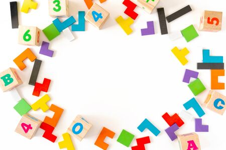 Photo pour Frame from colorful different shapes wooden blocks on white background. Natural, eco-friendly toys for children. Creative, logical thinking concept. Flat lay. Copt space. - image libre de droit