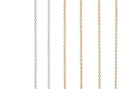 White and yellow gold chains isolated on white background