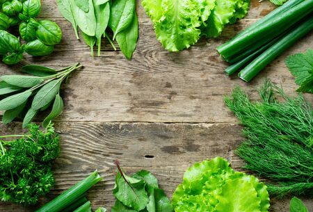 Photo for Frame of various fresh herbs on old wooden background. - Royalty Free Image