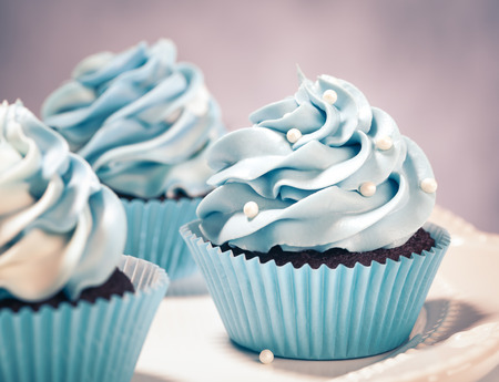 Blue Cupcakes on a plate. Vintage style.