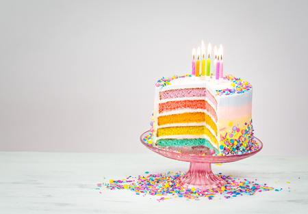 Colorful Rainbow Layered Birthday Cake With Lit Candles And Sprinkles Lizenzfreie Bilder Und Fotos