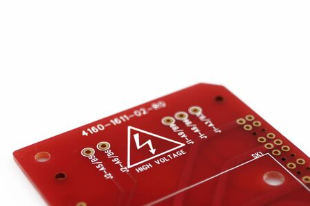 Photo pour Multiplied printed circuit boards PCB isolated on the white background. PCB assembly. High voltage warning and sign - image libre de droit
