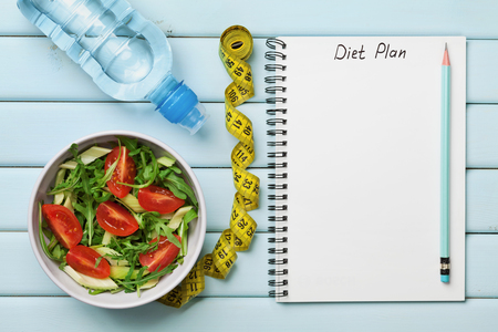 Photo for Diet plan, menu or program, tape measure, water and diet food of fresh salad on blue background, weight loss and detox concept, top view - Royalty Free Image
