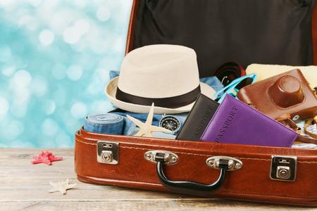 Foto de Packed vintage suitcase for summer holidays, vacation, travel and trip. Retro toning. - Imagen libre de derechos