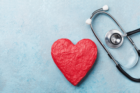 Photo for Red heart shape and medical stethoscope on blue background top view. Health care, medicare and cardiology concept. - Royalty Free Image