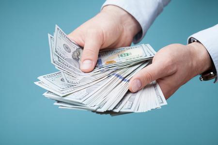Photo pour Man count money cash in his hand. Finance, saving, salary and donate concept. - image libre de droit