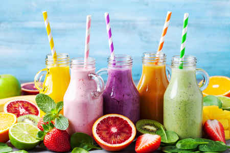 Photo for Summer colorful fruit smoothies in jars with ingredients. Healthy, detox and diet food concept. - Royalty Free Image