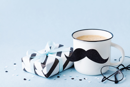 Photo for Creative breakfast on Happy Fathers Day with gift box and funny face from cup of coffee and moustache. - Royalty Free Image