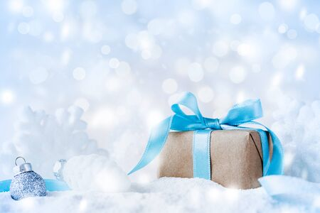 Photo pour Beautiful Christmas composition with gift or present box in snow and decoration against holiday lights background. - image libre de droit