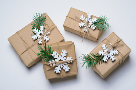 Foto de Christmas Gifts with Fir Branches and Wooden Snowflakes on White Background, Winter Holidays Concept - Imagen libre de derechos