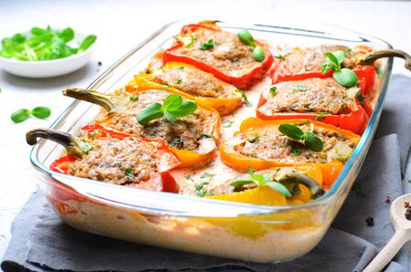 Photo for Stuffed Peppers with Meat, Vegetables and Creamy Tomato Sauce on Bright Background - Royalty Free Image
