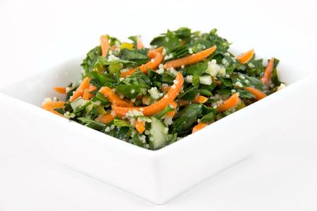Photo pour tabbouleh parsley and carrot salad bowl over white background - image libre de droit
