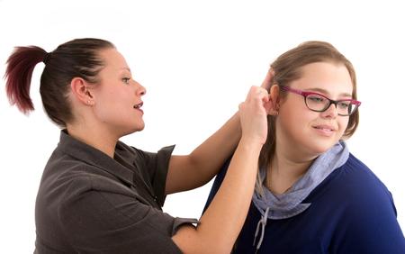 woman optician adjust glasses studio shot over white background